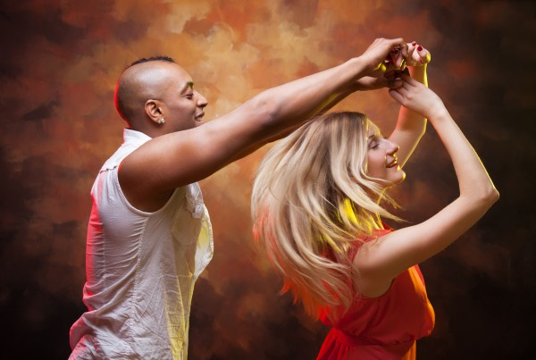 Young couple dances Caribbean Salsa. This image has attached release.