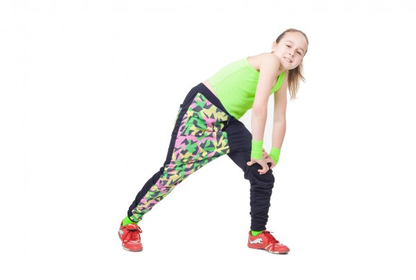 Happy little girl dancing hip-hop isolated on white background